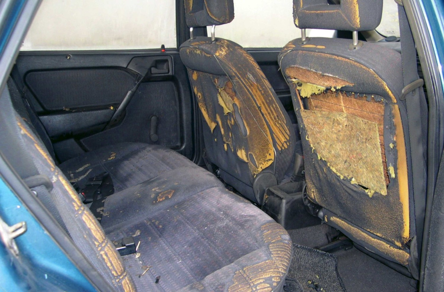 Matchsticks visible on the back seat of the killers' getaway car