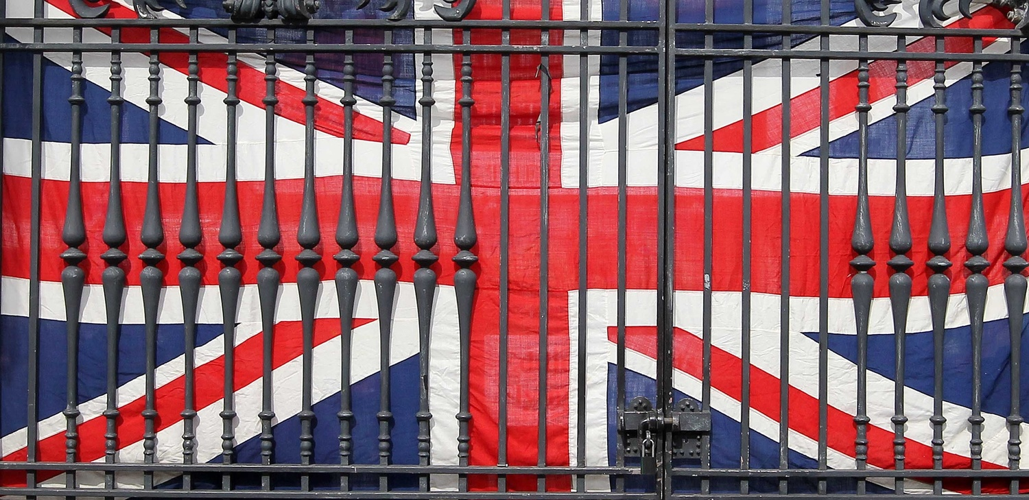 A Union flag behind fencing at Belfast City Hall during protests over the flying of the emblem.