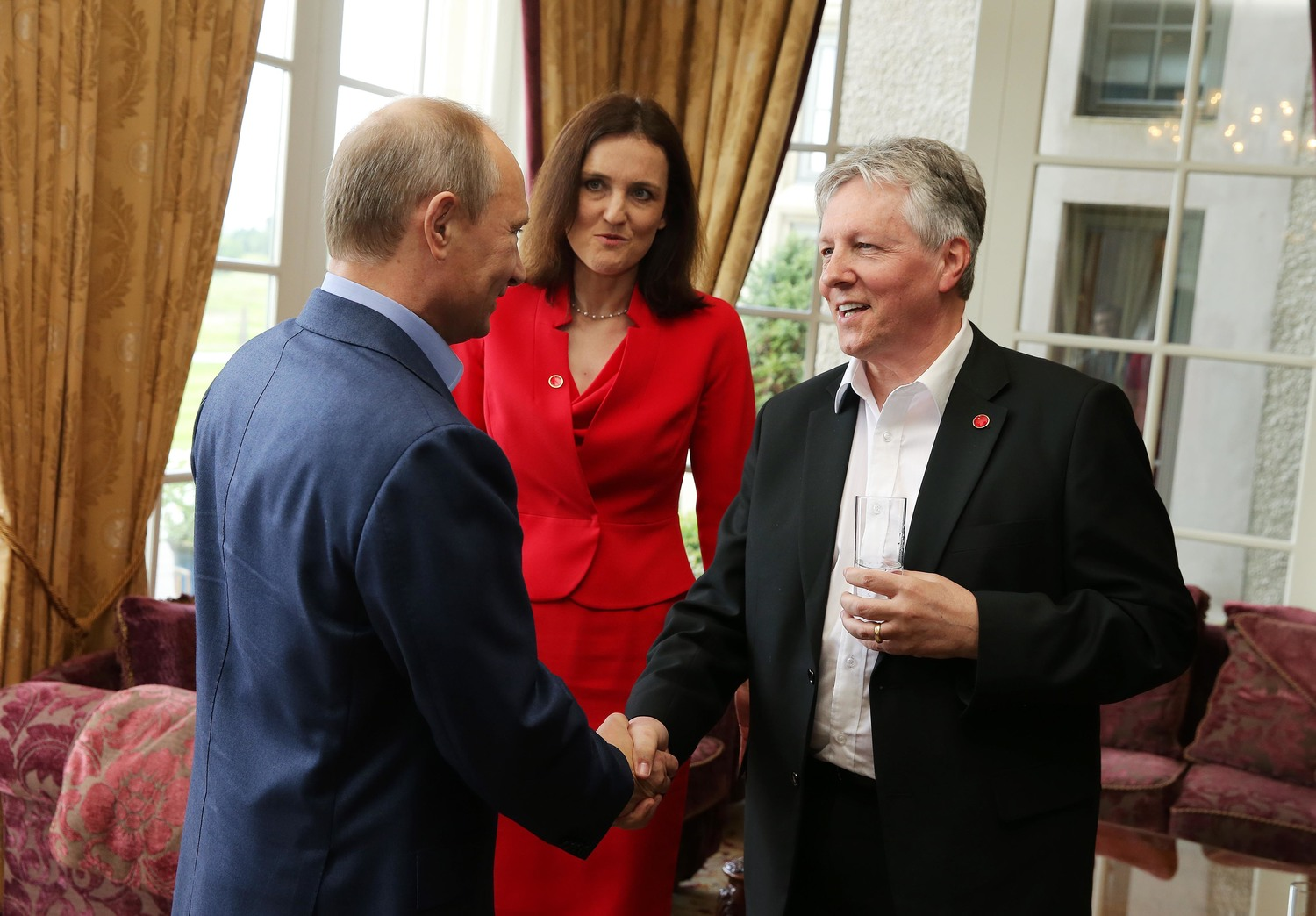 Vladimir Putin meets Peter Robinson while his Russian delegation searches for a satellite site in Clogher