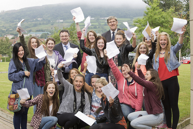 John O'Dowd & Stephen Farry with St Genevieve's High pupils on GCSE result day