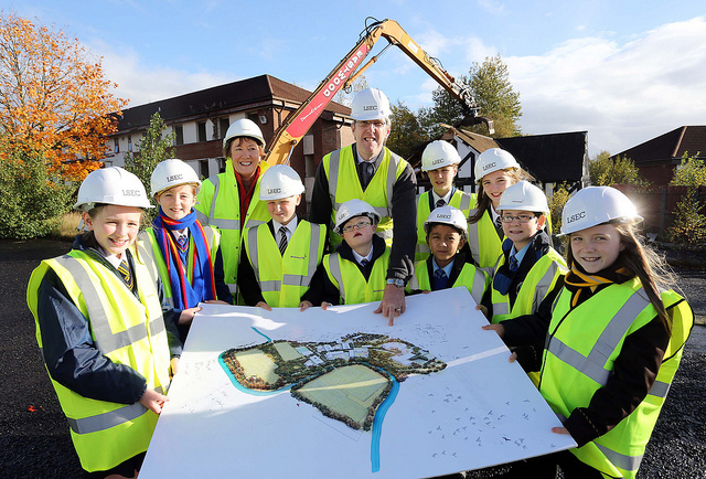 Minister John O'Dowd with Hazel Jones (Lisanelly Programme Director) and pupils from six local schools relocating to the new Lisanelly Shared Education Campus