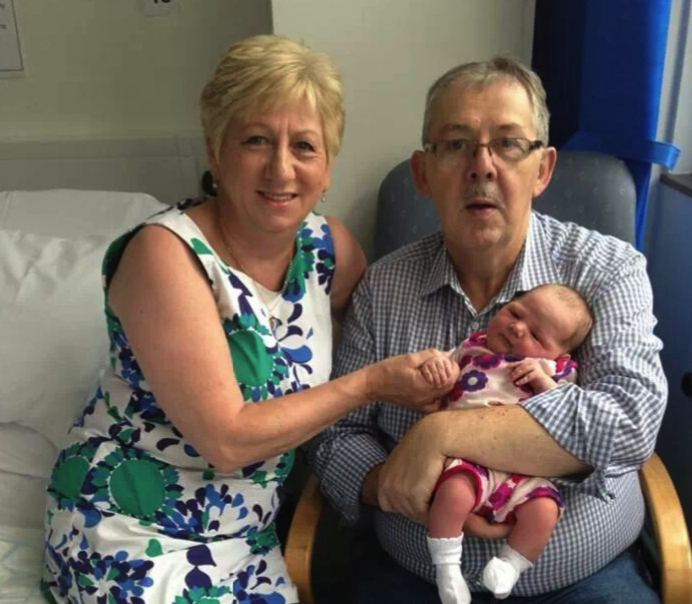 Alfie Hannaway and his wife Dympna pictured with one of their 20 grandchildren