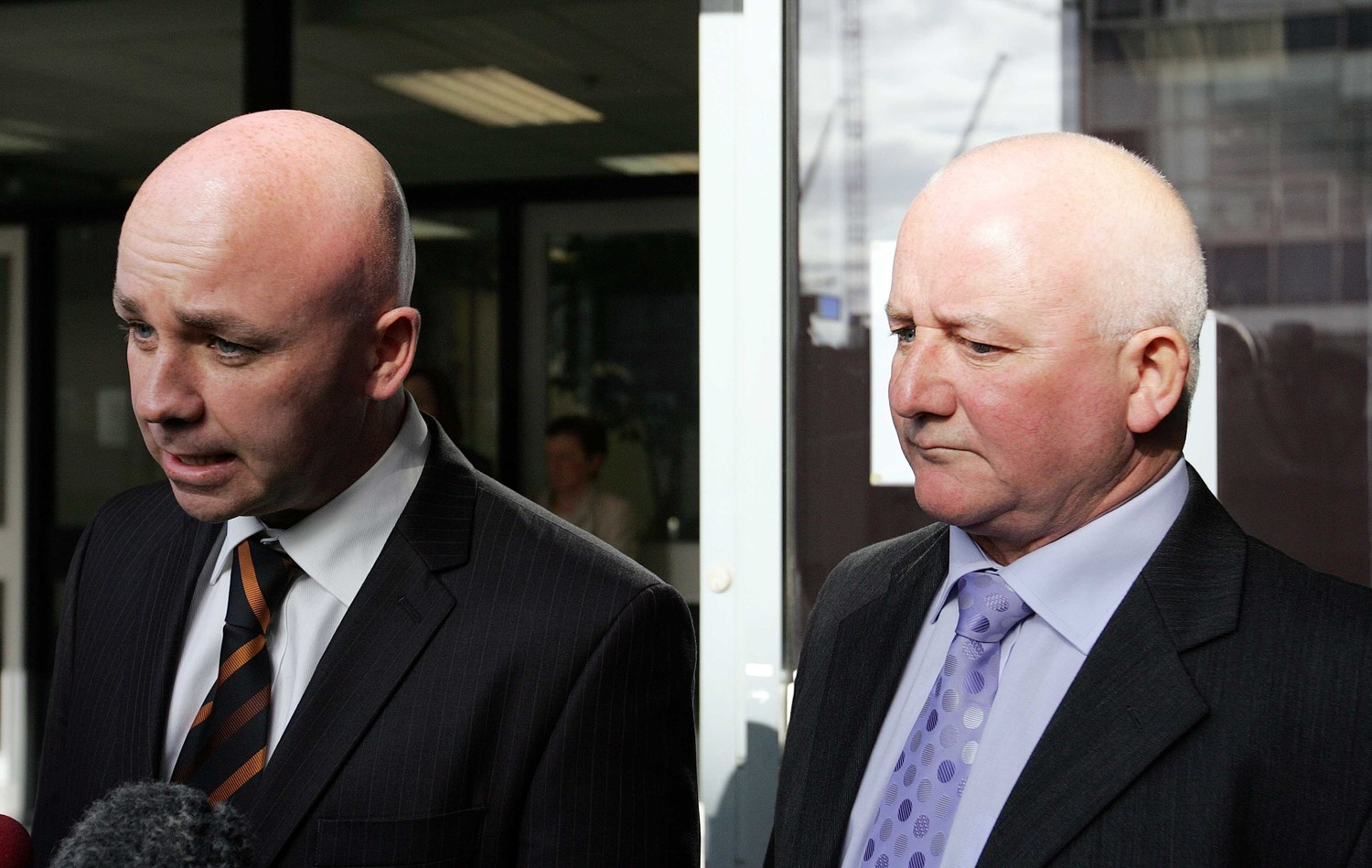 Rosemary Nelson's brothers Eunan and Tony Magee address reporters at the inquiry