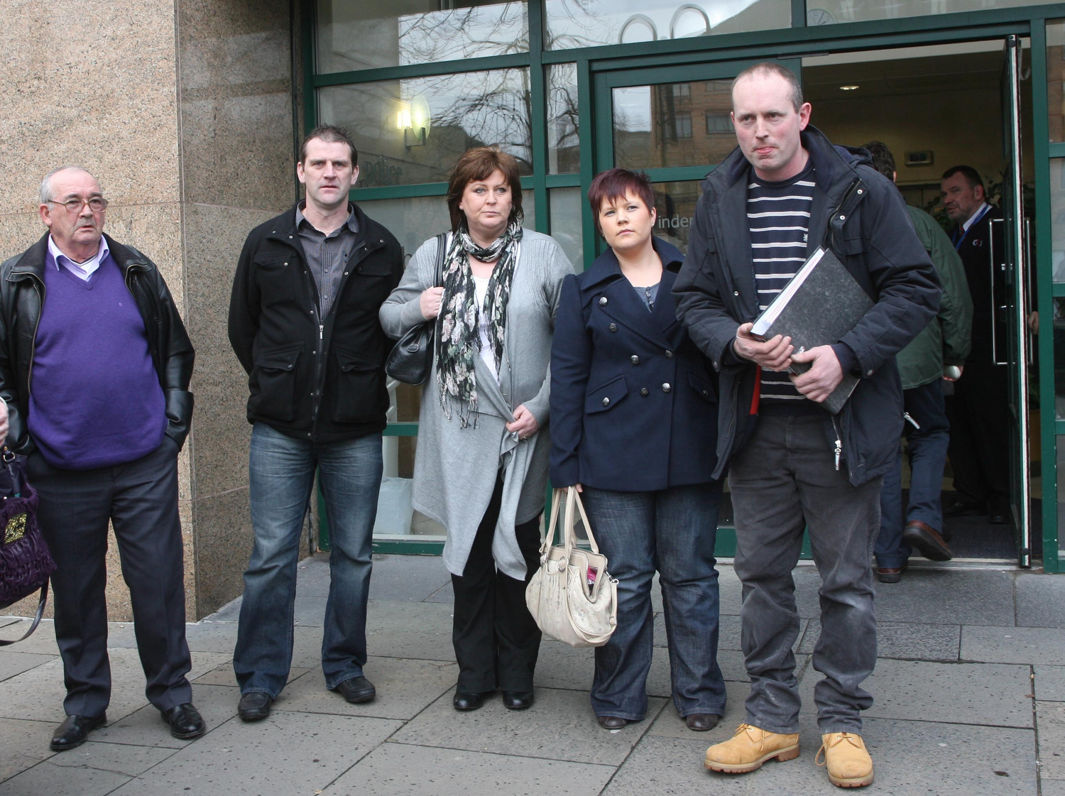 Loughinisland families arrive at a meeting at Police Ombudsman headquarters
