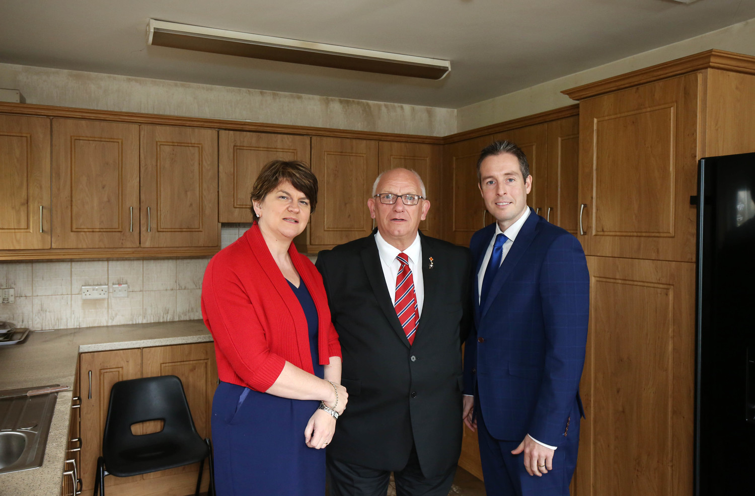 DUP leader Arlene Foster and outgoing Communities Minister Paul Givan with Billy Thomspon, centre, from Orange Community Network, at the launch of the community halls fund in October last year.