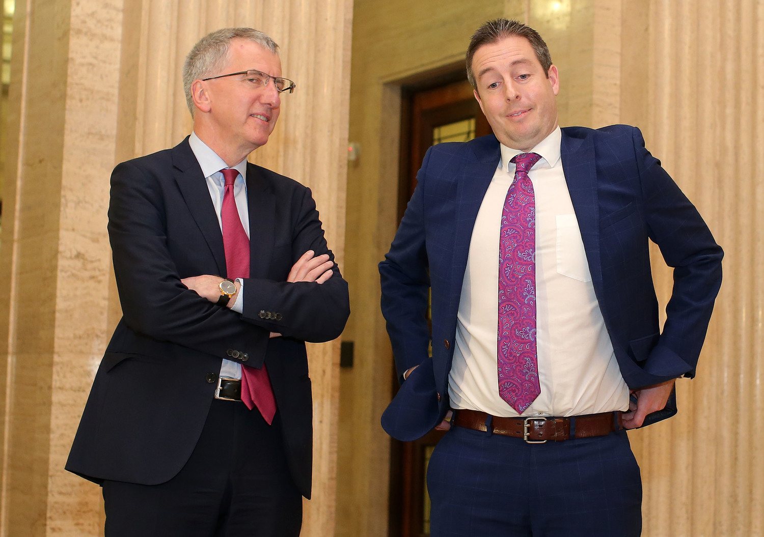 Sinn Féin former Finance Minister Martin Ó Muilleoir, left, and DUP former Communities Minister Paul Givan pictured at Stormont following the resignation of the late Deputy First Minister Martin McGuinness which was, in part, blamed on the decision to close an Irish-language bursary scheme.