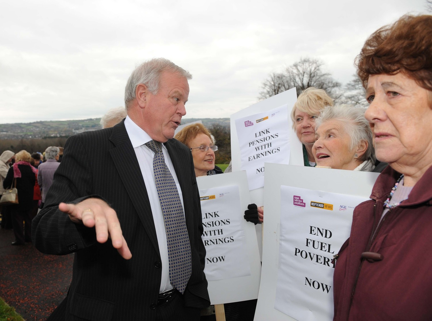Pensioners campaigning against fuel poverty confront MLA pension fund chairman Trevor Lunn