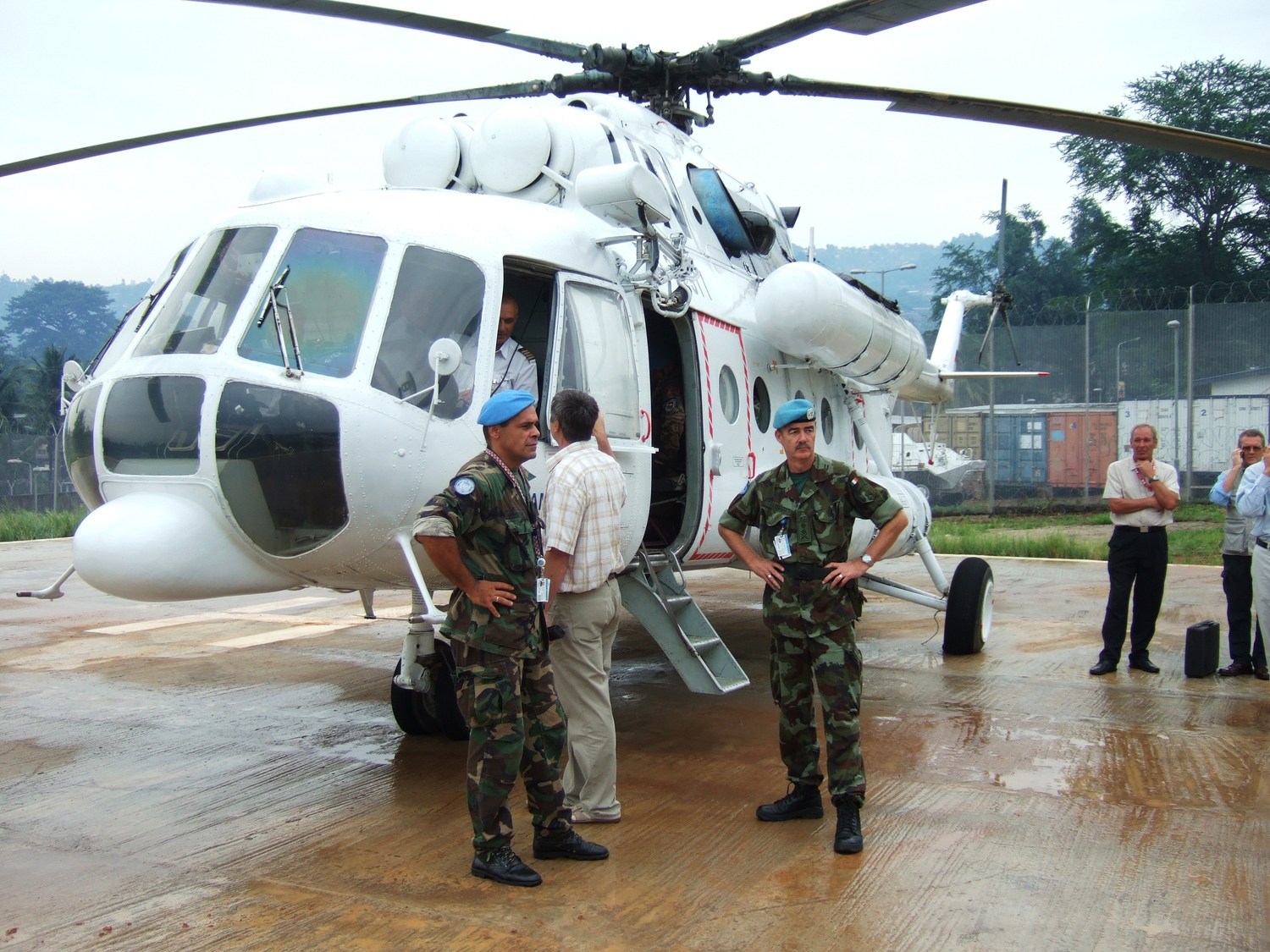 Pakenham (right) with Lt Col Goran Novoselic- UNMIL's Deputy Chief Operations Officer (Air) on the tarmac in Sierra Leone