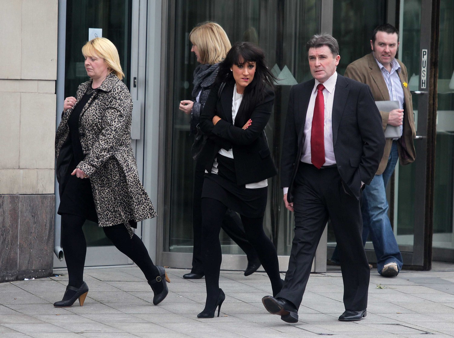 Martin McCaughey and Dessie Grew's families leave court