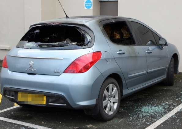 A car belong to a Housing Executive employee was petrol bombed less than a week after the religious figures were published