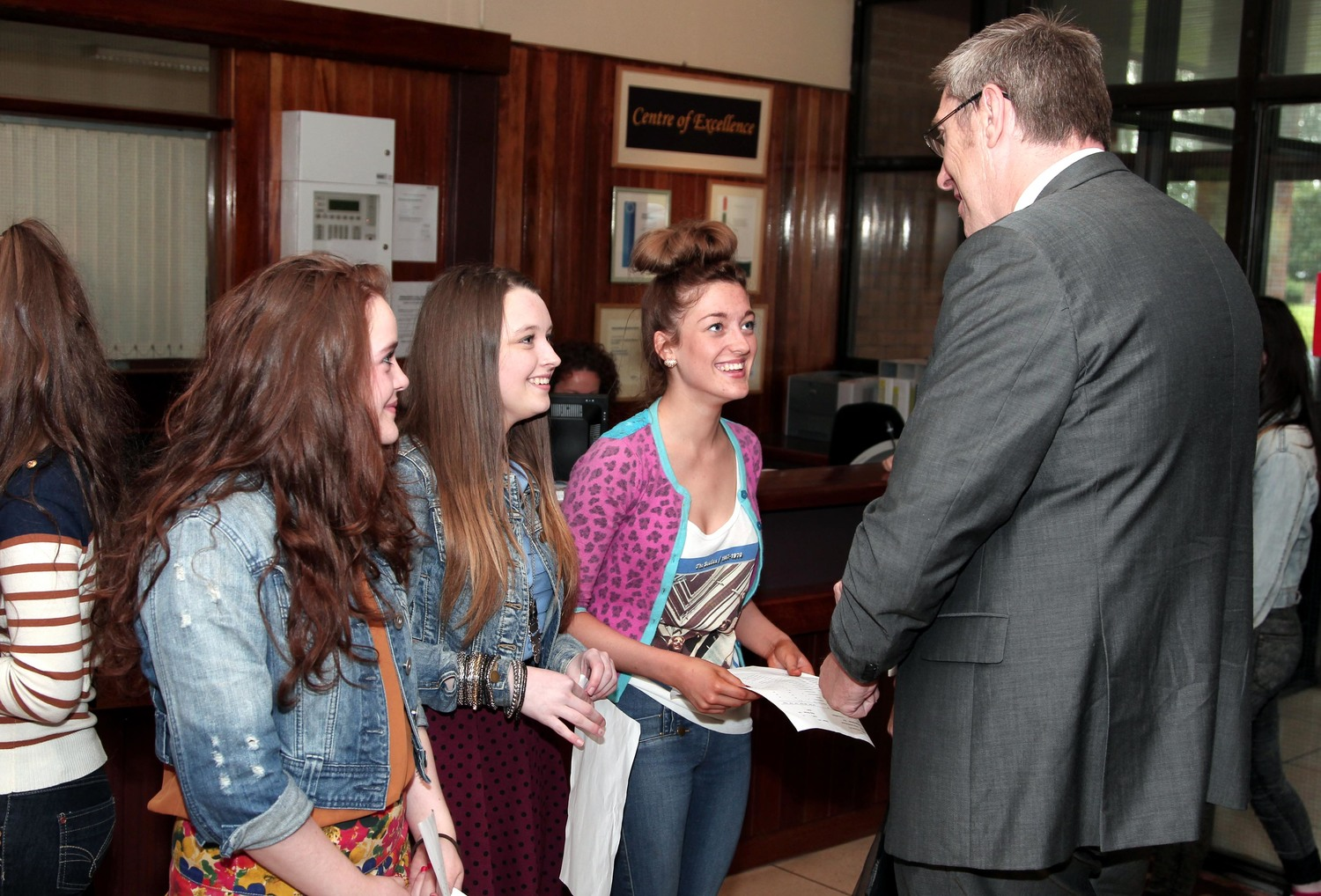 GCSE results day 2012: John O'Dowd at St Louise's Comprehensive College in Belfast