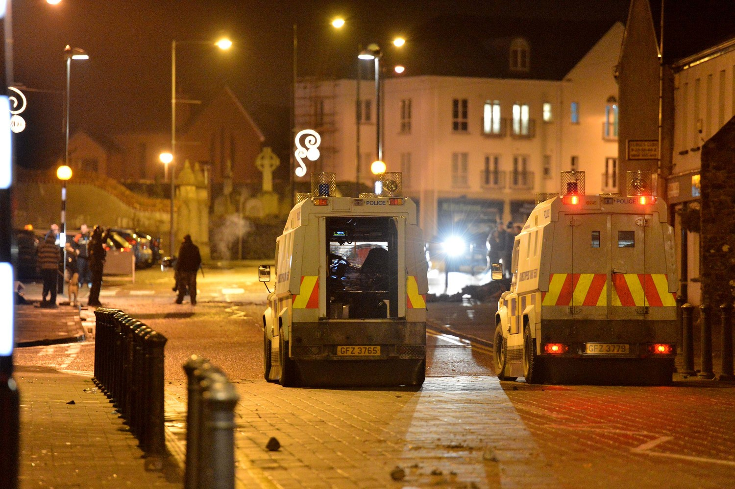Police in Carrickfergus attacked after loyalists destroyed Alliance Party premises