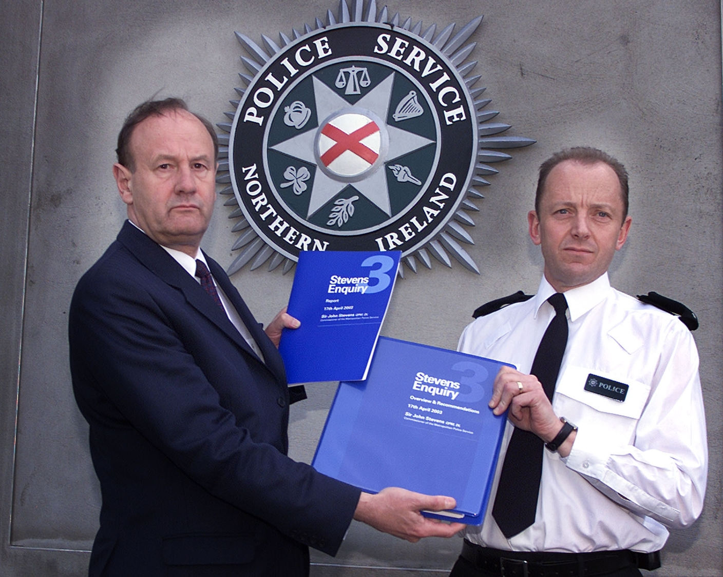 John Stevens delivers his report to then PSNI Chief Constable Hugh Orde