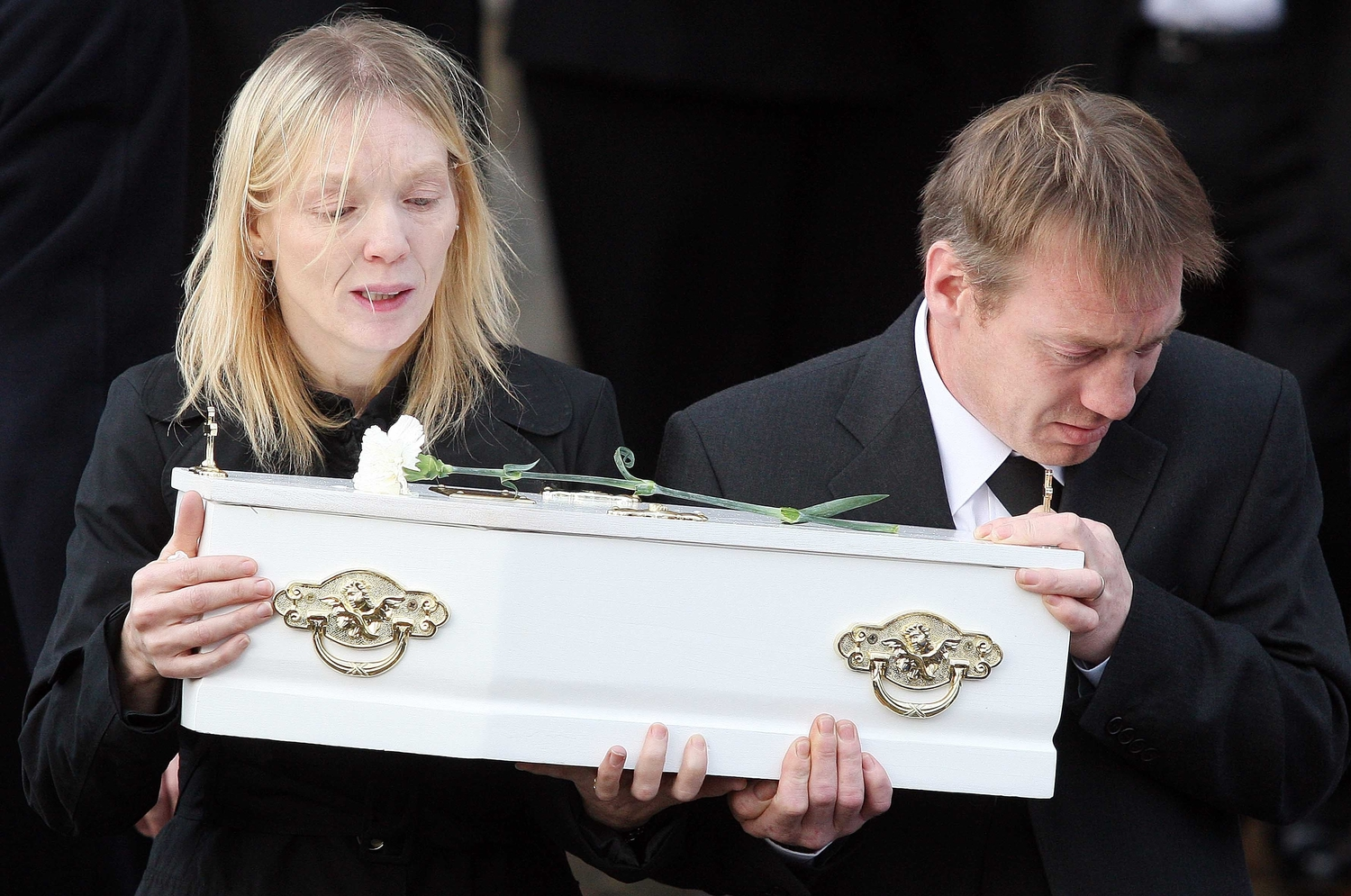 Killed by his father: the coffin of baby James McElhill carried by relatives