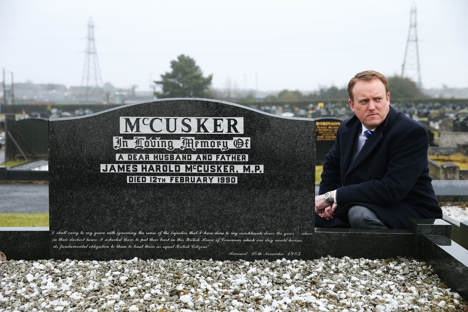 Colin McCusker beside his father Harold's grave