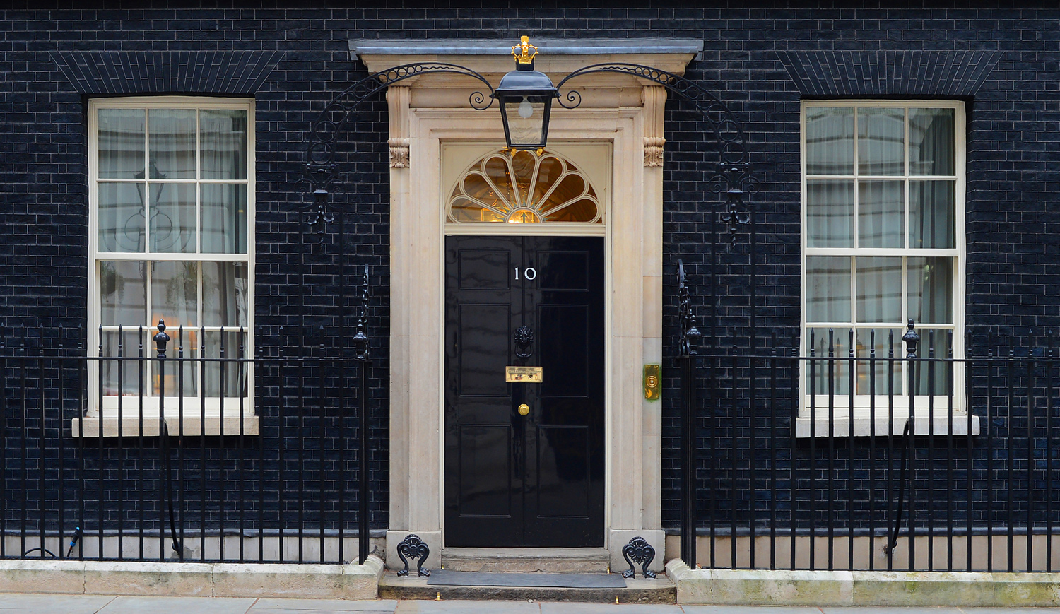 No 10 Downing Street - an Open Govt image of the iconic black door of the Prime Minister's residence.